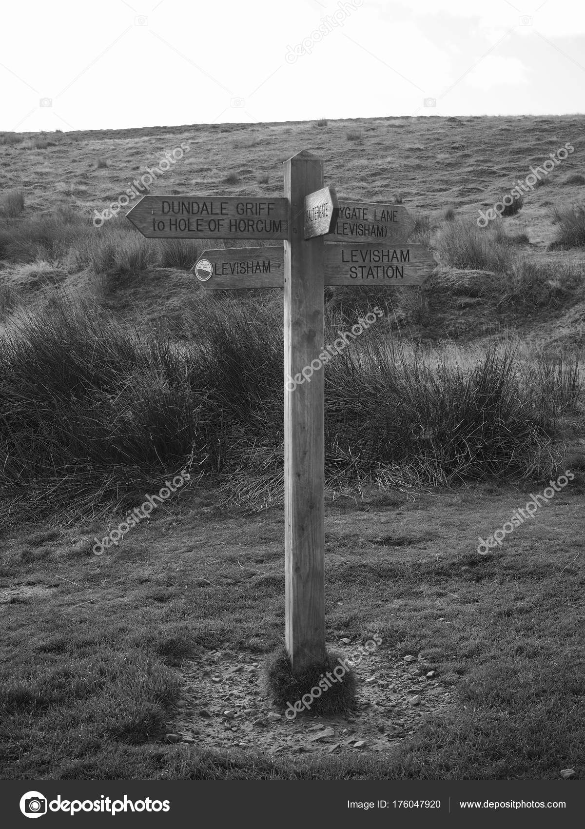 Signpost on walking paths shot in black and white near hole of horcum and levisham in north york moors national park yorkshire