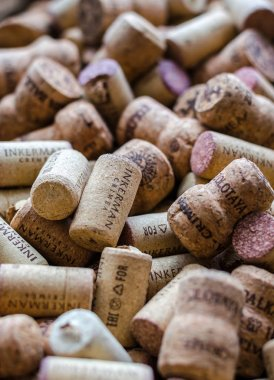 Evpatoria, Crimea, Russia, August 15, 2018. Background of excuse corks of various brands of Crimean wine.
