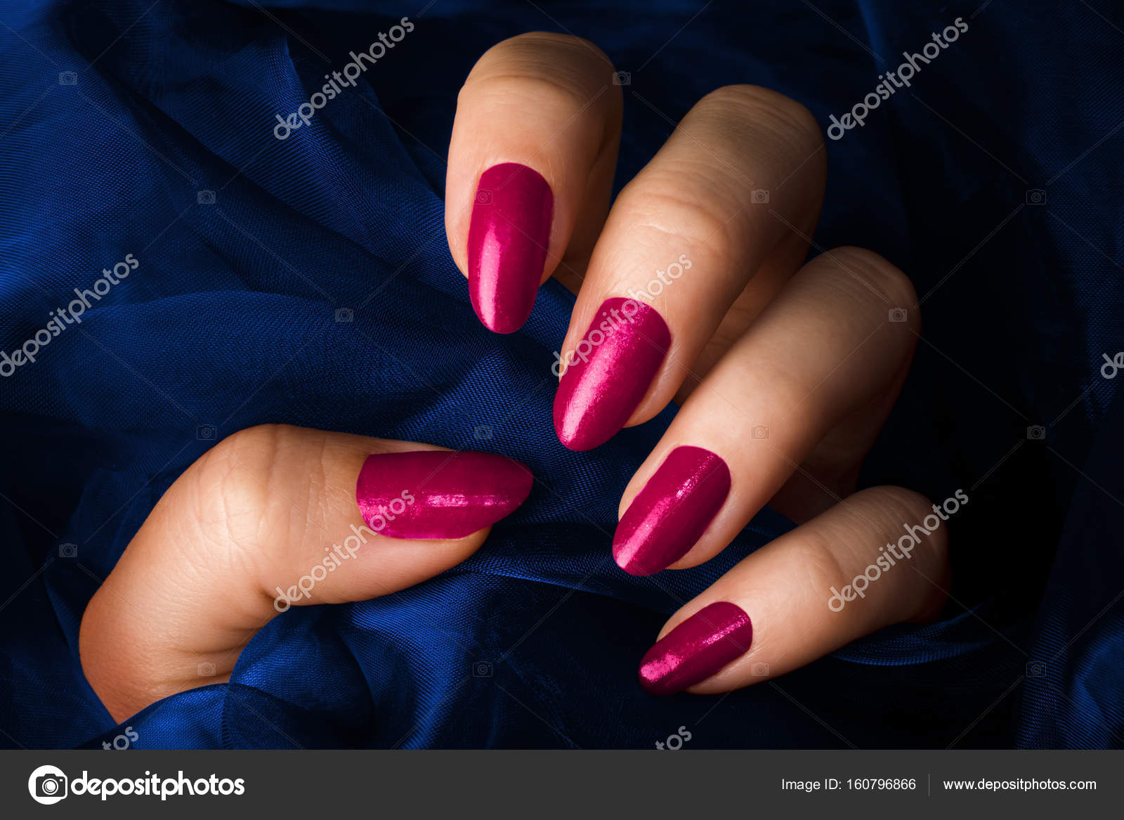 pink nails on dark blue background — Stock Photo © gyurma #160796866