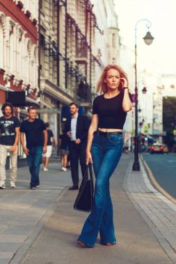 woman walks on the street at the Moscow