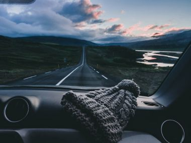 majestic view from car with knitted hat on the road in Iceland