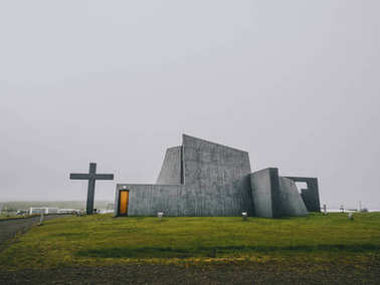 Modern church, concrete construction, with a large cross, new parish church, Bloendus, Blonduos, Iceland