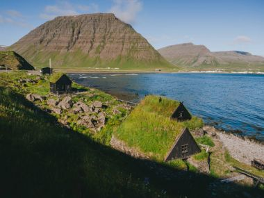 Iceland Snaefellsnes peninsula landscape with traditional houses with grass roofs