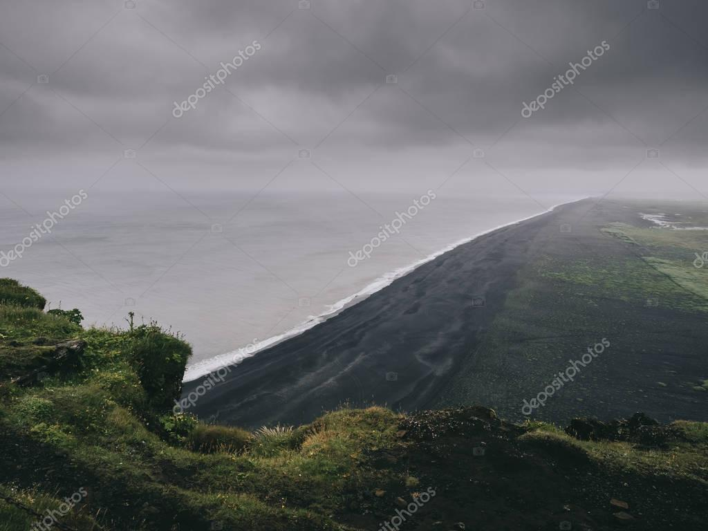 scenic view of black sand beach from cliff, Vik, Iceland
