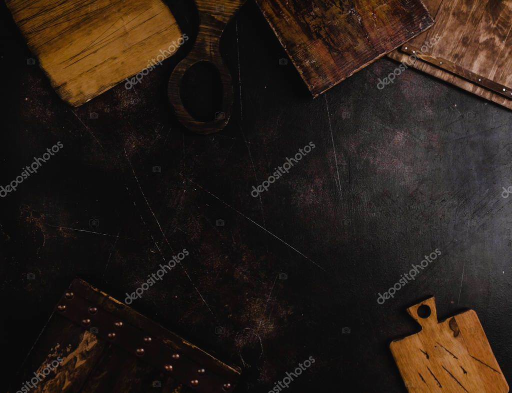 top view of wooden cutting boards on black surface