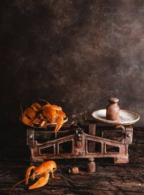 close-up view of delicious lobsters on vintage scales on rustic table top