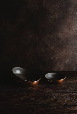 close-up view of empty vintage utensils on rustic wooden table