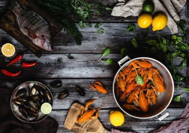 top view of various delicious seafood on rustic wooden table