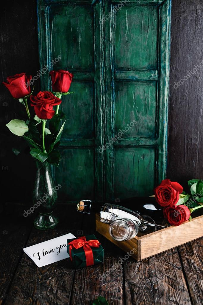 i love you greeting card, gift, red roses and champagne bottle with glasses for valentines day