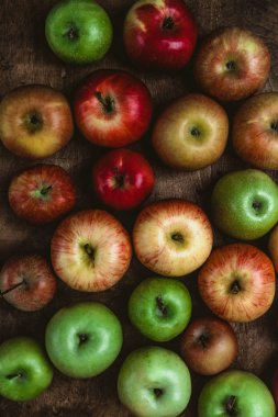 top view of different apples on rustic wooden table