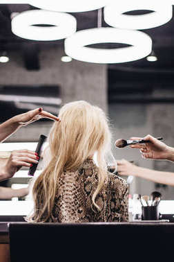 Blond woman in beauty salon, beauty professionals at work