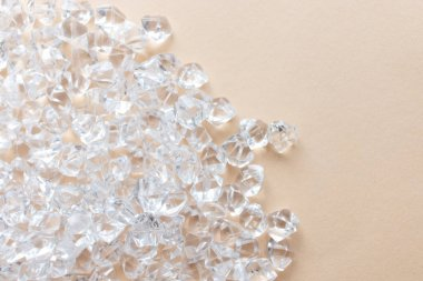 scattered crystals on light background, beautiful gems