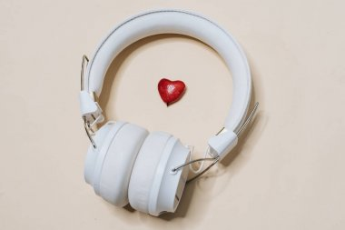 White modern headphones, listening music