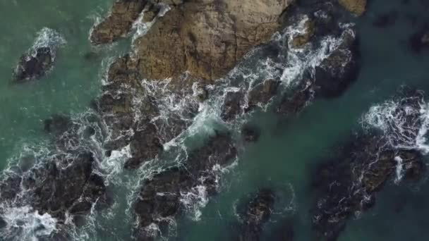 Aerial view of ocean waves and mountains. Malibu beach top view