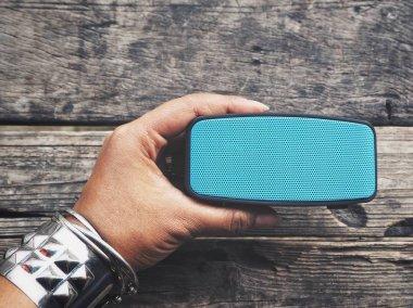Woman using bluetooth speaker