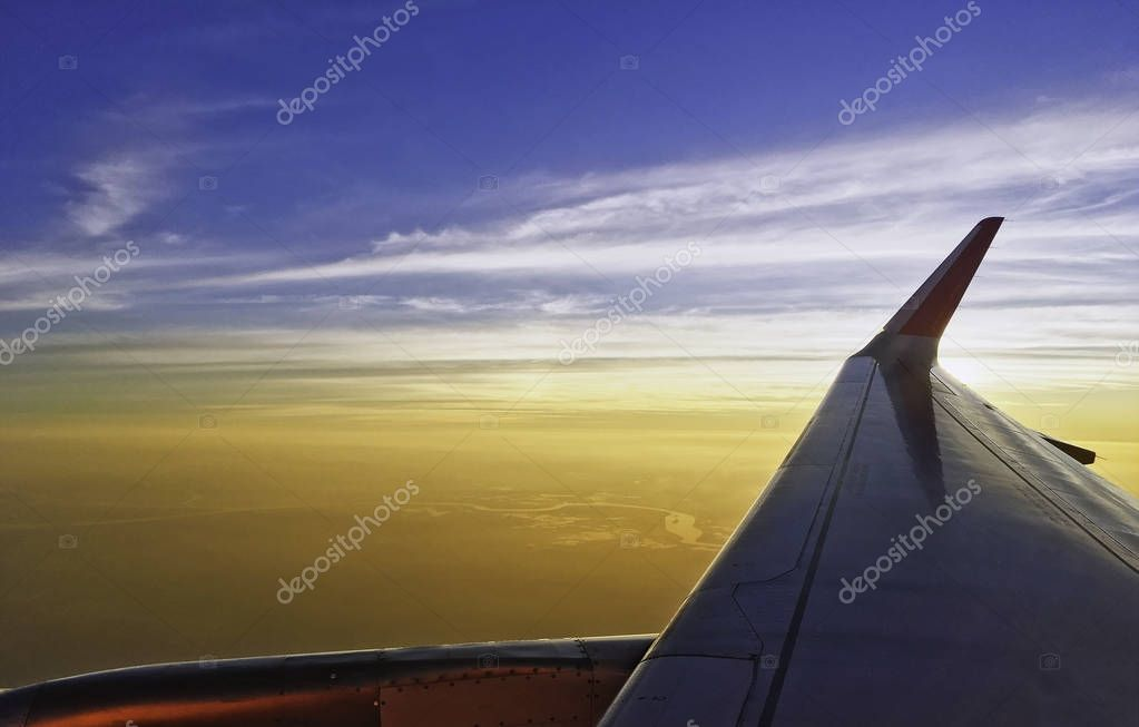 sun setting over the horizon cloud sky twilight through airplane