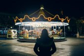 Girl looks merry-go-round