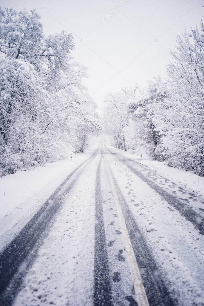 Snowy landscape road traffic zone.