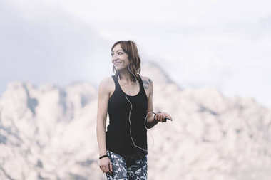 Woman listens to music for sports.