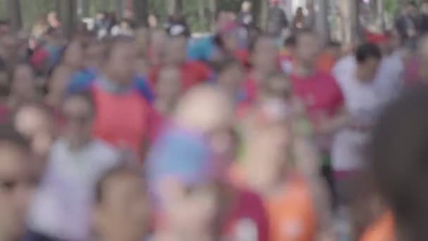 Defocused image of people running marathon.