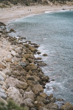 View of the sea coast with stones.