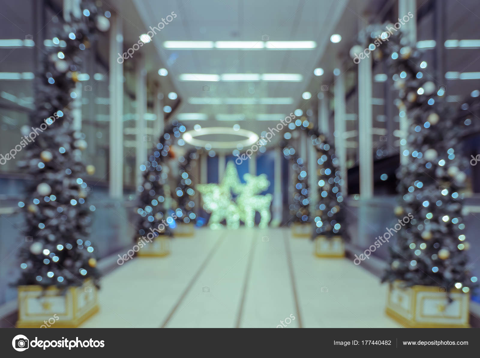 blurred abstract background of office hotel lobby or shopping mall building indoor with light illuminated christmas tree photo by boonsom