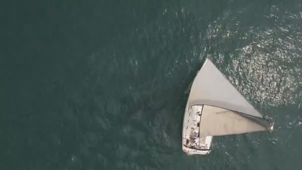 Flying over sea with sailboat