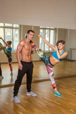 Modern dancers practicing in dance studio
