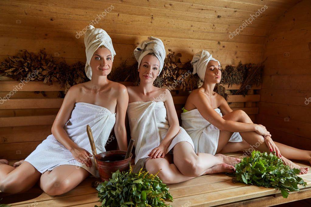 Three girls relaxing in sauna — Stock Photo © Svetography