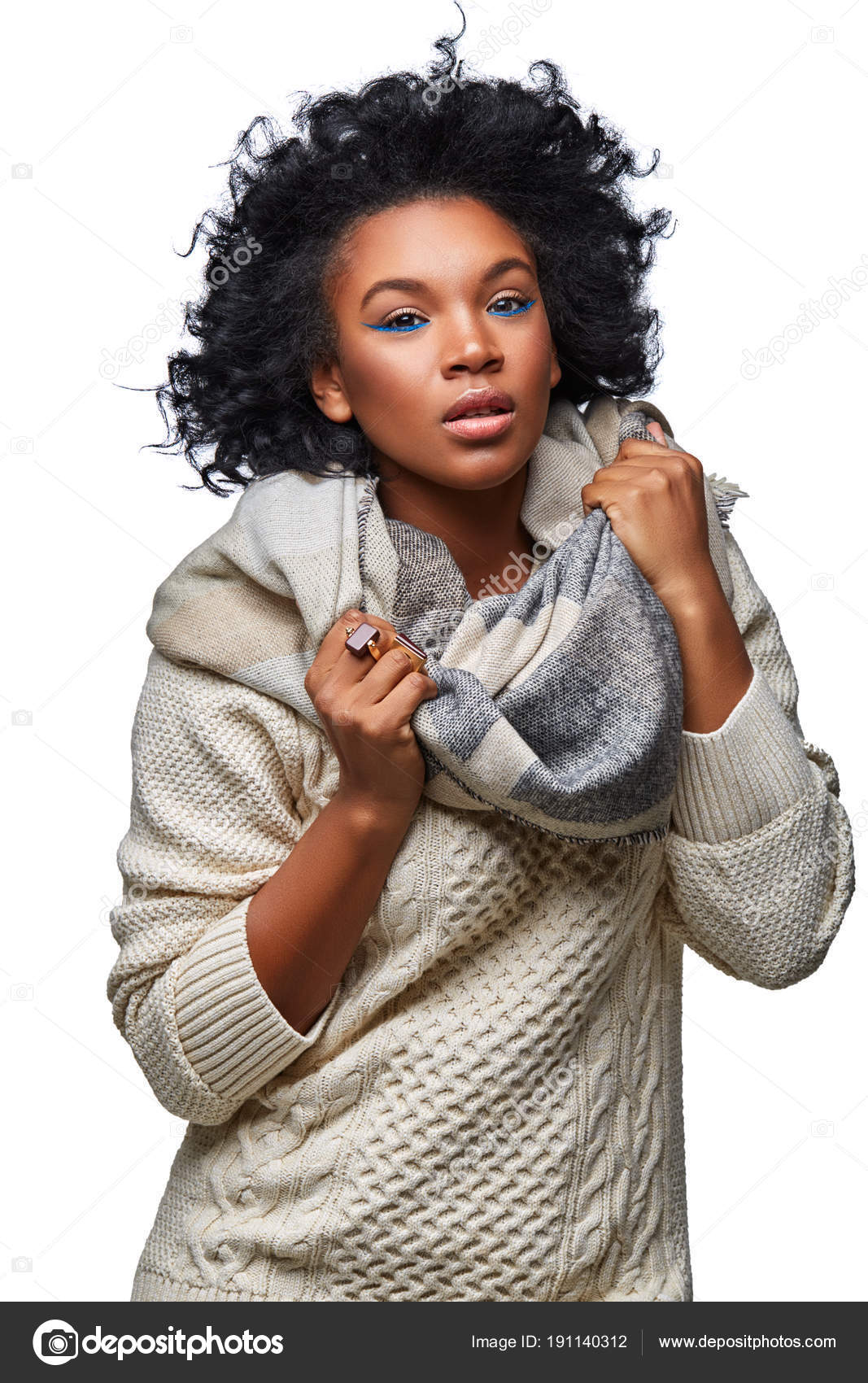 5ee16030c6 Beautiful dark skin young woman with blue eye makeup wearing sweater and  scarf. studio beauty shot isolated on white background. copy space.