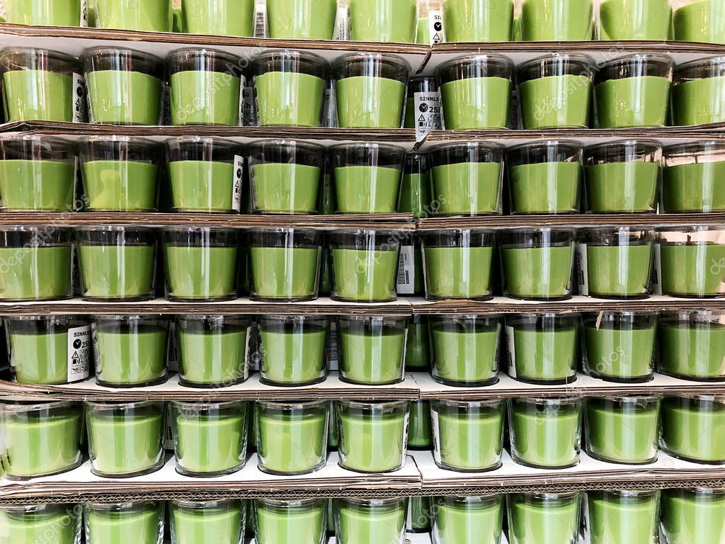 RISHON LE ZION, ISRAEL- DECEMBER 16, 2017: Natural soy wax without the smell of a candle in a glass jar.