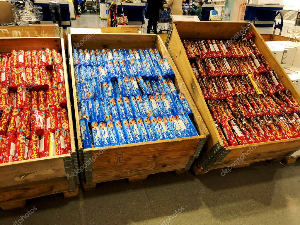 RISHON LE ZION, ISRAEL- DECEMBER 16, 2017: Various brands of soft biscuits in the package for sale on the stand or shelf or supermarket box.