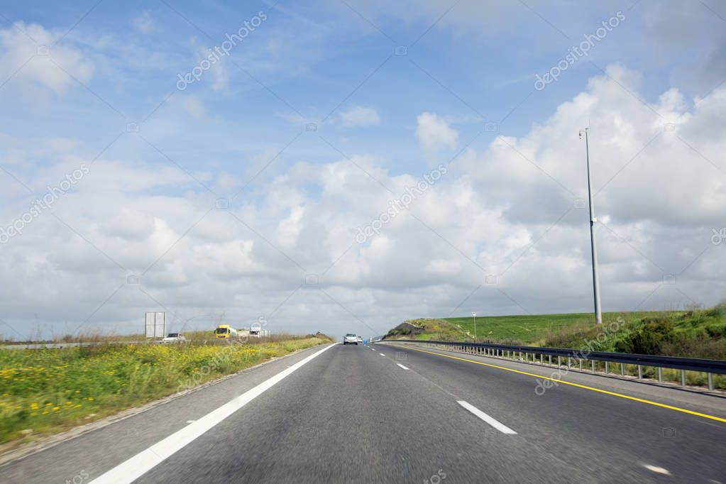 NAHARIYA, ISRAEL- MARCH 9, 2018: Cars on the road on the way to the north of Israel