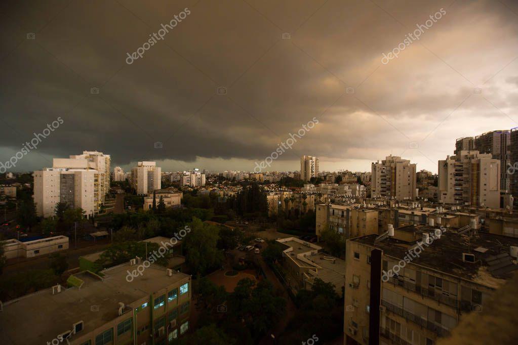 RISHON LE ZION, ISRAEL -APRIL 25, 2018: Dark clouds asperatus before the storm over the city