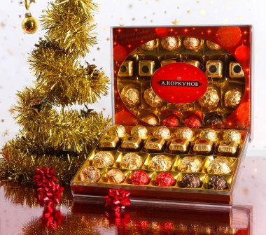 Collection of A. Korkunov chocolates and Christmas tree with Golden branches.