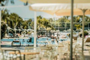 Swimming pool in hot summer day tilt shift