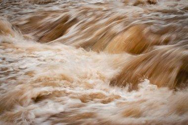 blurred wild muddy river