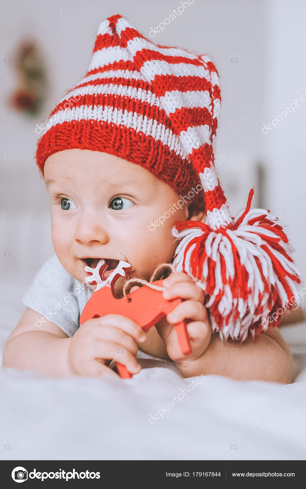 b264d8c8acd Close Portrait Infant Child Red White Striped Hat Pompom Playing — Stock  Photo