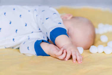 close-up shot of infant baby sleeping in bed surrounded with cotton balls