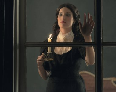 Woman holding candlestick