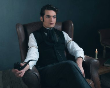 victorian man sitting in leather chair