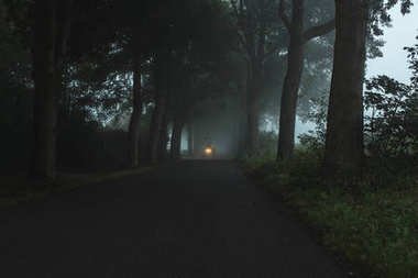 Misty country road with tractor