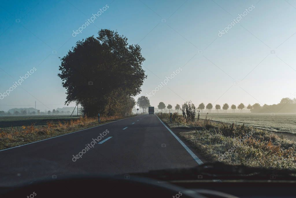 Highway in rural misty landscape