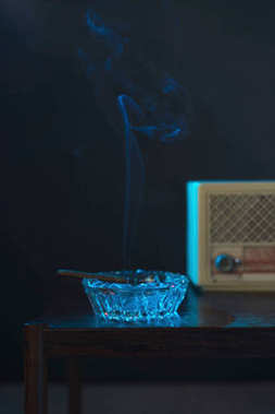 Ashtray with cigarette and transistor radio