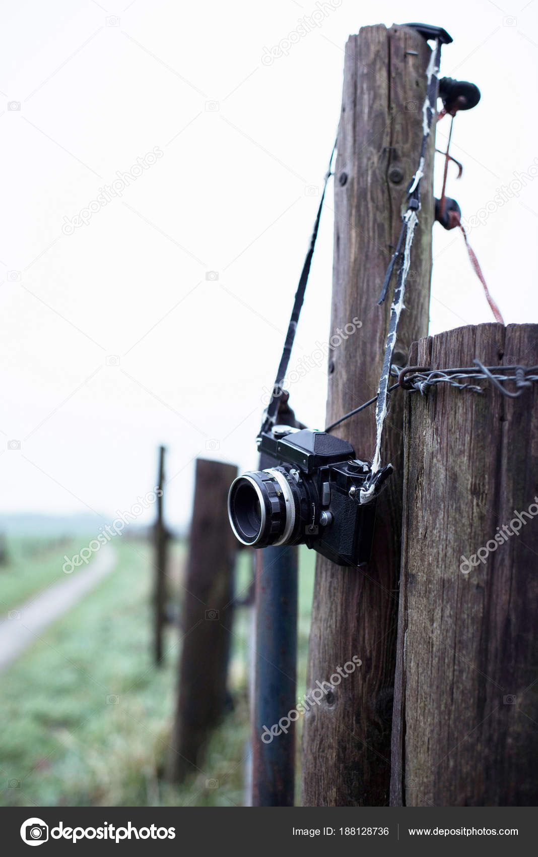 Lost camera hanging on fence post — Stock Photo © ysbrand #188128736