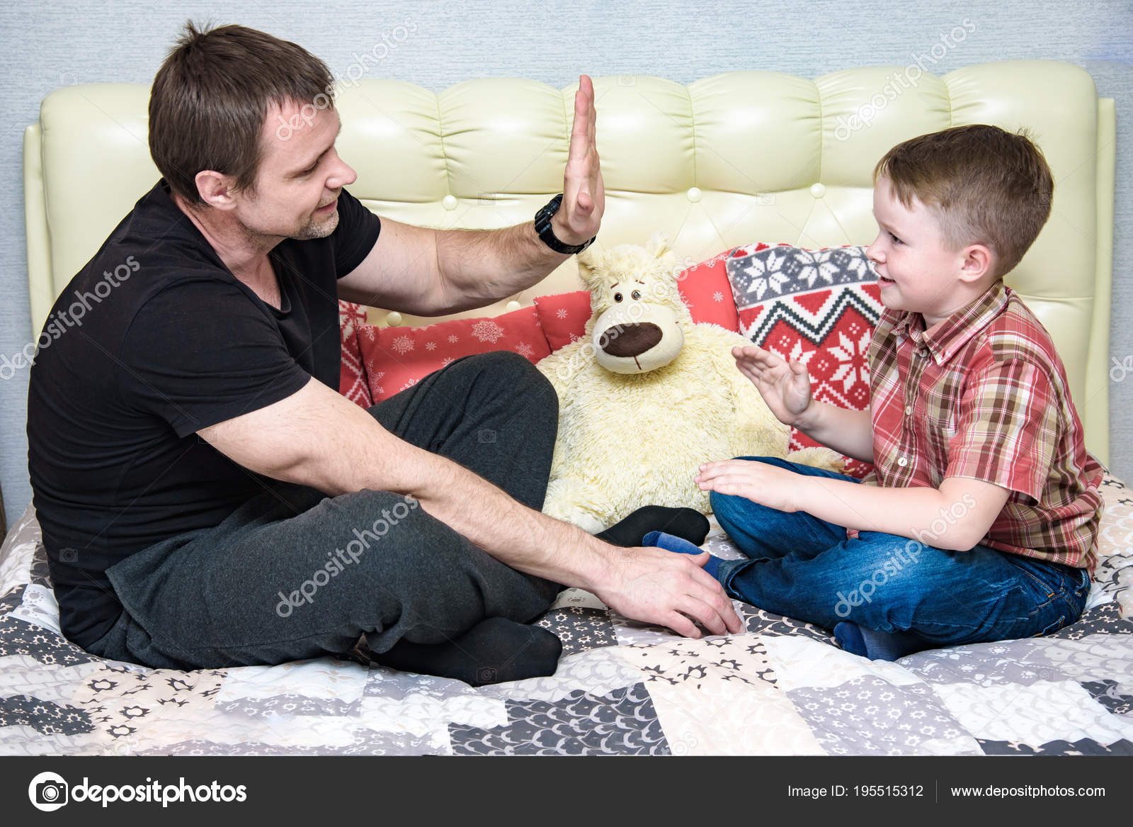 Dad And Son Play Sitting On The Bed Stock Photo C Govorkov Photo