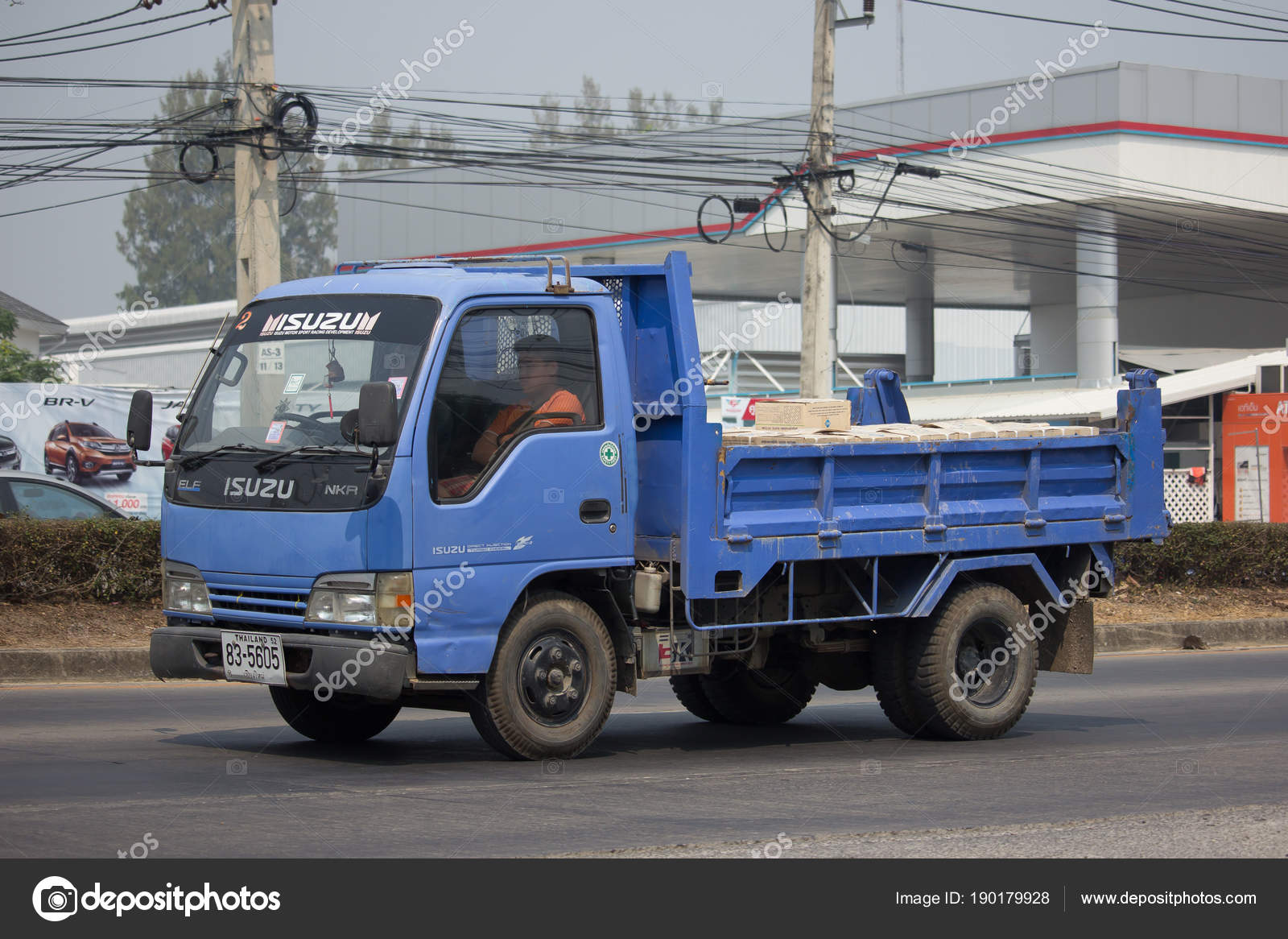 CHIANG MAI, THAILAND  MARCH 6 2018: Private Isuzu Dump Truck. On Road  No.1001 8 Km From Chiangmai Business Area. U2014 Photo By Nitinut380