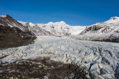 Aerial view of the Sv nafellsj kull glacier in sunny weather. The beginning of spring in Iceland