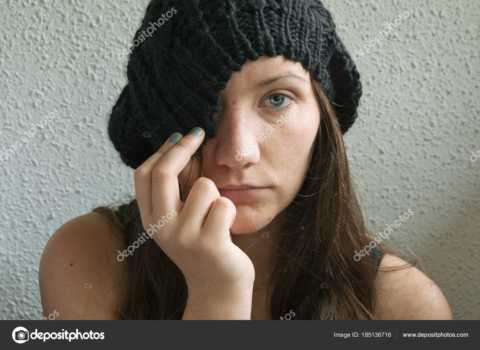 d208ba04352 Girl with long hair and blue eyes partially covering her face with her hat  — Photo by ...