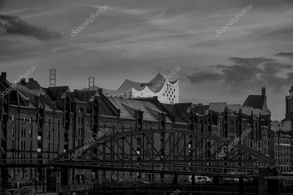 the old warehouse district Speicherstadt in Hamburg, Germany with Elbphilharmonie concert hall in background,